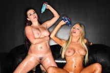 Hot lesbians use glitter baby oil on each other.